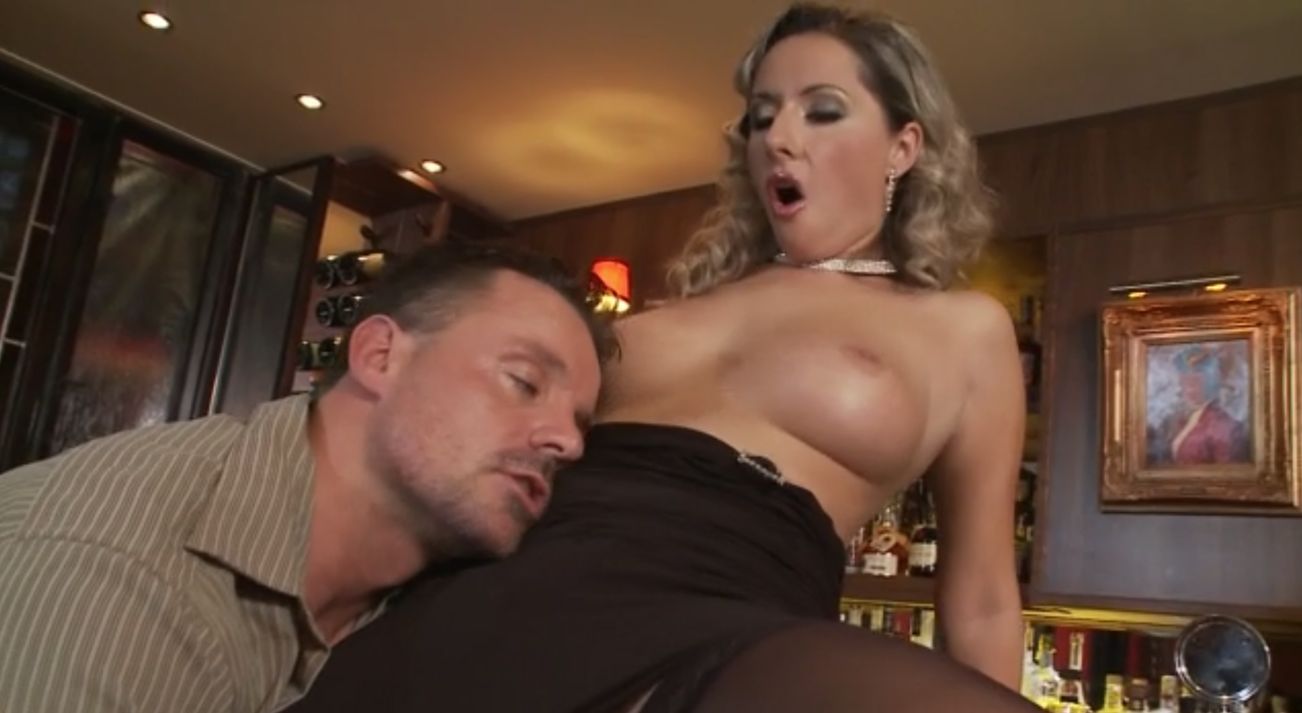 Curly slut takes cock at the bar
